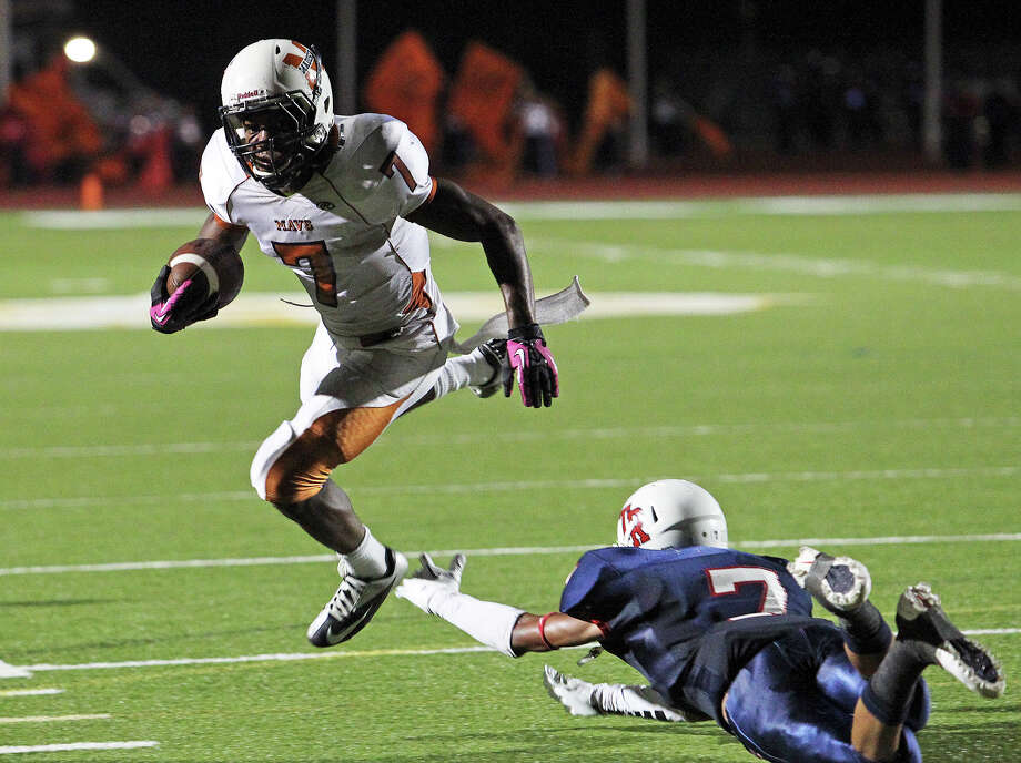 Maverick running back Marquis Warford clears Steven Marshall on a touchdown run in the second quarter as Madison plays Roosevelt at Heroes Stadium on October 5, 2012. Photo: Tom Reel, Express-News / ©2012 San Antono Express-News