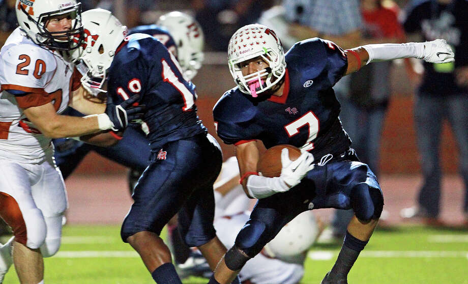 Running back Steven Marshall changes directions as he runs for the Rough Riders as Madison plays Roosevelt at Heroes Stadium on October 5, 2012. Photo: Tom Reel, Express-News / ©2012 San Antono Express-News