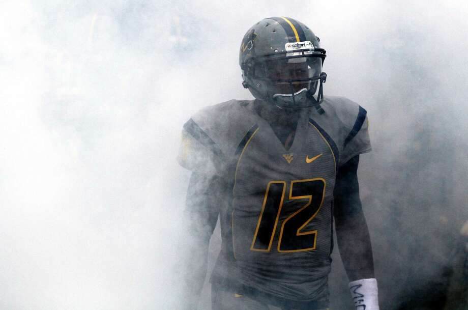 MORGANTOWN, WV - SEPTEMBER 22: Geno Smith #12 of the West Virginia Mountaineers leads the team onto the field before the game against the Maryland Terrapins on September 22, 2012 at Mountaineer Field in Morgantown, West Virginia. Photo: Justin K. Aller / 2012 Getty Images