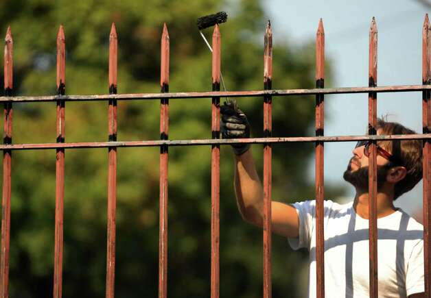 Painter Josh Baron of Tritan Builders paints the wrought-iron fence at Union College in Schenectady, NY Friday Oct. 5, 2012. (Michael P. Farrell/Times Union) Photo: Michael P. Farrell