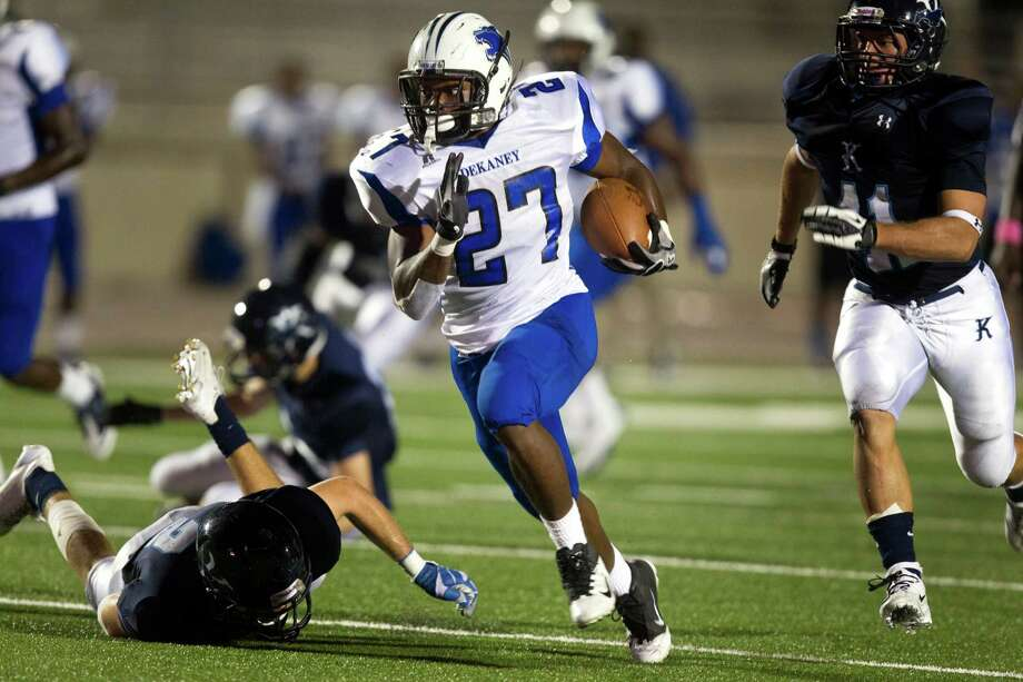 Dekaney's running back Demarcus Felton (27) takes off against the Kingwood Mustangs during the second quarter of a high school football game at Turner Stadium on Friday, Oct. 5, 2012, in Humble. Photo: J. Patric Schneider, For The Chronicle / © 2012 Houston Chronicle
