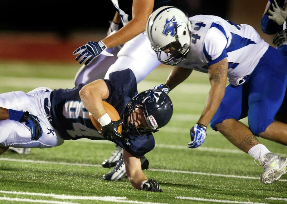 Kingwood's Kade Harrington (84) is brought down by Dekaney's Cody Perdue (44) during the second quarter of a high school football game at Turner Stadium on Friday, Oct. 5, 2012, in Humble. Photo: J. Patric Schneider, For The Chronicle / © 2012 Houston Chronicle