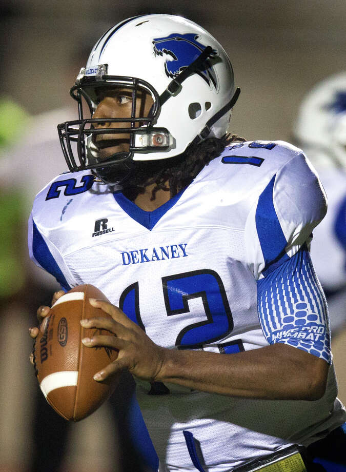 Dekaney quarterback D'Juan Hines (12) looks for an open man against the Kingwood Mustangs during the first half of a high school football game at Turner Stadium on Friday, Oct. 5, 2012, in Humble. Photo: J. Patric Schneider, For The Chronicle / © 2012 Houston Chronicle