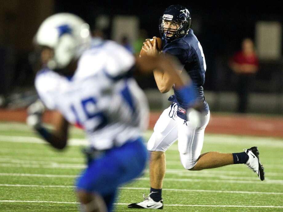 Kingwood quarterback Logan Clift (8) looks for open man against Dekaney during the first half of a high school football game at Turner Stadium on Friday, Oct. 5, 2012, in Humble. Photo: J. Patric Schneider, For The Chronicle / © 2012 Houston Chronicle