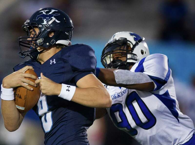 Kingwood quarterback Logan Clift (8) is brought down by Dekaney linebacker Deon Booker-Brown (90) du
