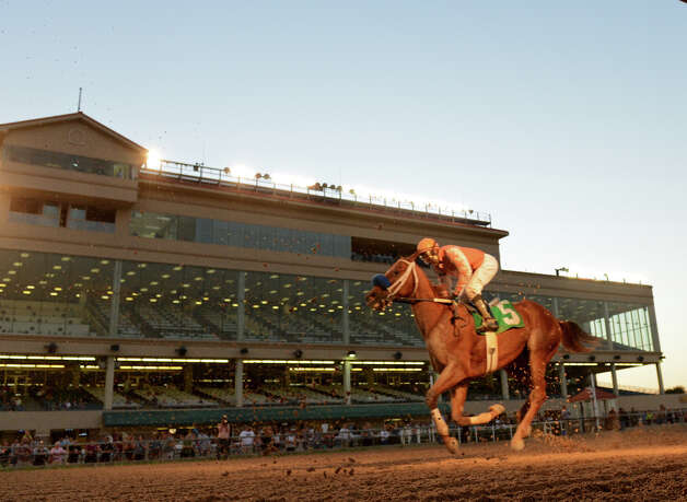 A horse crosses the finish line during Retama Park's opening night of the 2012 thoroughbred horse racing season in Selma, Friday, October 5, 2012.