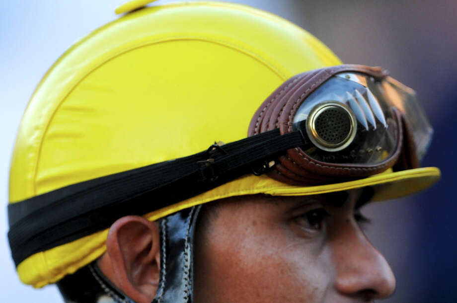 A Jockey's helmet and goggles during Retama Park's opening night of the 2012 thoroughbred horse racing season in Selma, Friday, October 5, 2012.