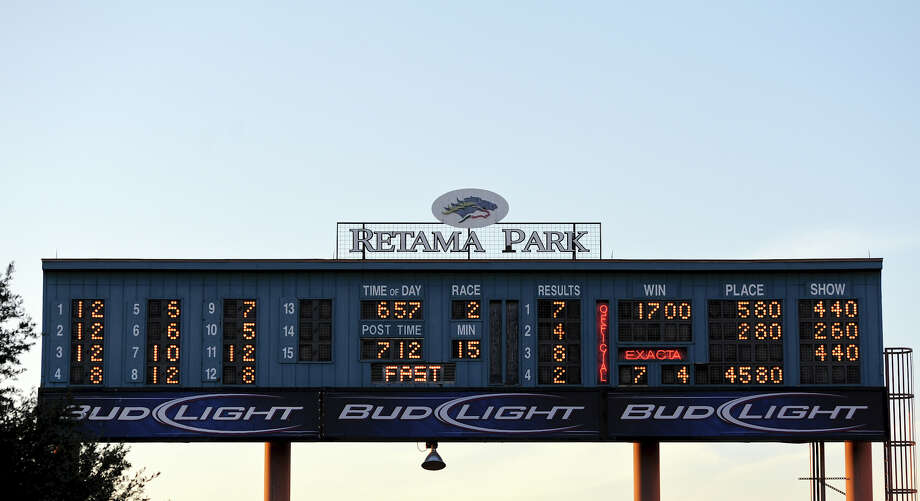 The tote board over the paddock during Retama Park's opening night of the 2012 thoroughbred horse racing season in Selma, Friday, October 5, 2012.
