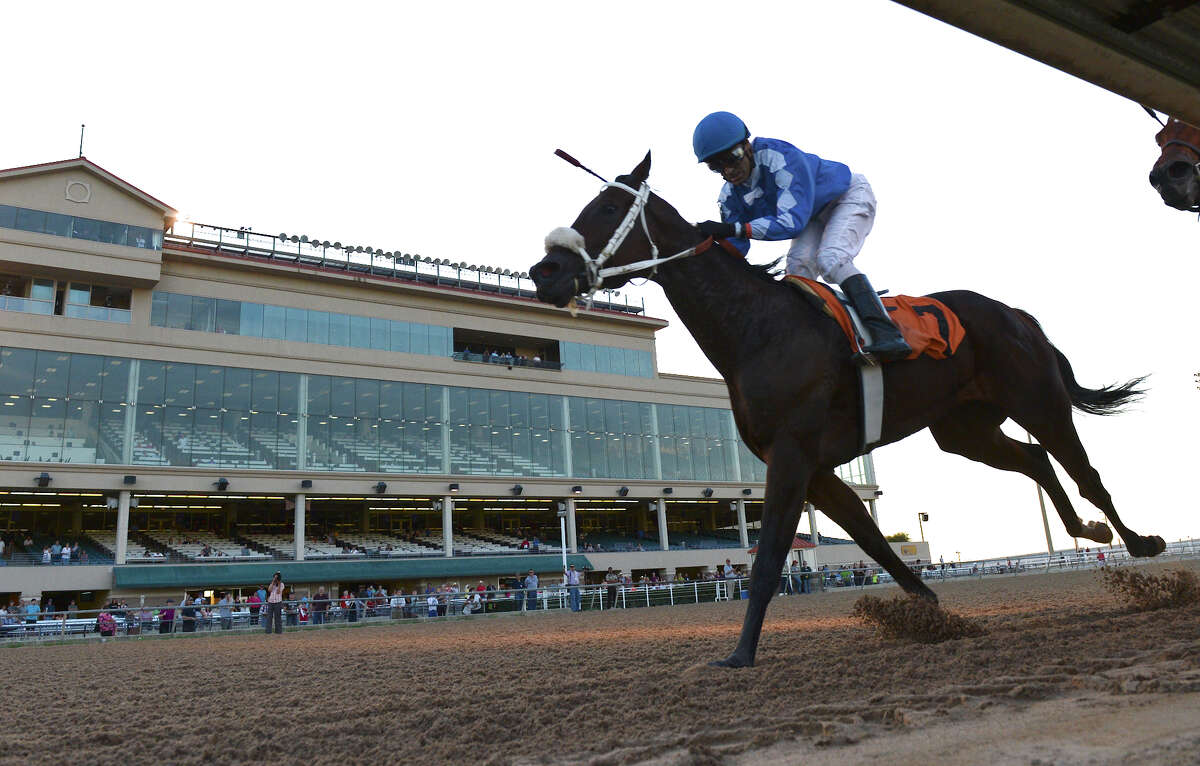 I Know Joe and jockey Jose Manuel Figueroa cross the finish line and take first place in the first race during Retama Park's opening night of the 2012 thoroughbred horse racing season in Selma, Friday, October 5, 2012. John Albright / Special to the Express-News.
