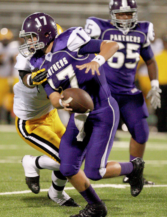 10/5/12: Ridge Point's Jesse Crebbe #17 is sacked by Fort Bend Marshall's Allen Smith #9 in a Class 4A high school football game at Hall Stadium in Missouri, Texas. Photo: Thomas B. Shea, For The Chronicle / © 2012 Thomas B. Shea
