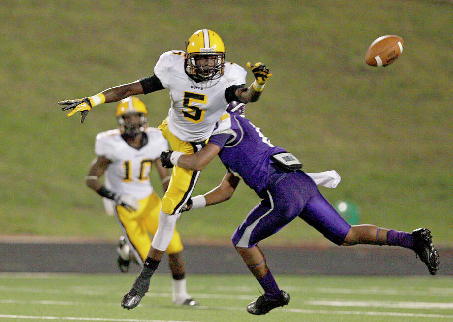 10/5/12: Fort Bend Marshall's Jeremiah Baines #5 is hit by Ridge Point's Camyron Brown #6 in a Class 4A high school football game at Hall Stadium in Missouri, Texas. Photo: Thomas B. Shea, For The Chronicle / © 2012 Thomas B. Shea