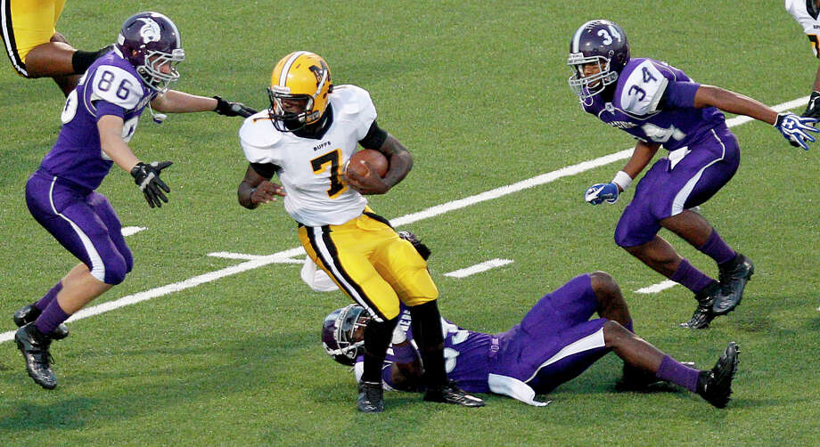 10/5/12: Fort Bend Marshall's JW Ketchum #7 is surrounded by Ridge Point's defense in a Class 4A high school football game at Hall Stadium in Missouri, Texas. Photo: Thomas B. Shea, For The Chronicle / © 2012 Thomas B. Shea