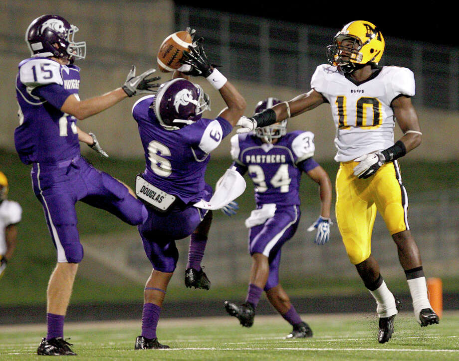 10/5/12: Ridge Point's Camyron Brown #6 intercepts the ball away from Fort Bend Marshall's Elijah Sample #10 in a Class 4A high school football game at Hall Stadium in Missouri, Texas. Photo: Thomas B. Shea, For The Chronicle / © 2012 Thomas B. Shea