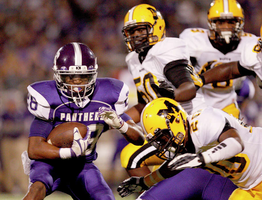 10/5/12: Ridge Point's Je'Marcus Johnson #28 can't turn the corner against the Fort Bend Marshall's defense in a Class 4A high school football game at Hall Stadium in Missouri, Texas. Photo: Thomas B. Shea, For The Chronicle / © 2012 Thomas B. Shea