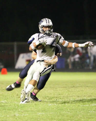 West Orange-Stark receiver J'Marcus Rhodes, No. 14, is tackled by Shane O'Bannion during the game Friday against Hardin-Jefferson in Sour Lake. Matt Billiot Photo: Matt Billiot