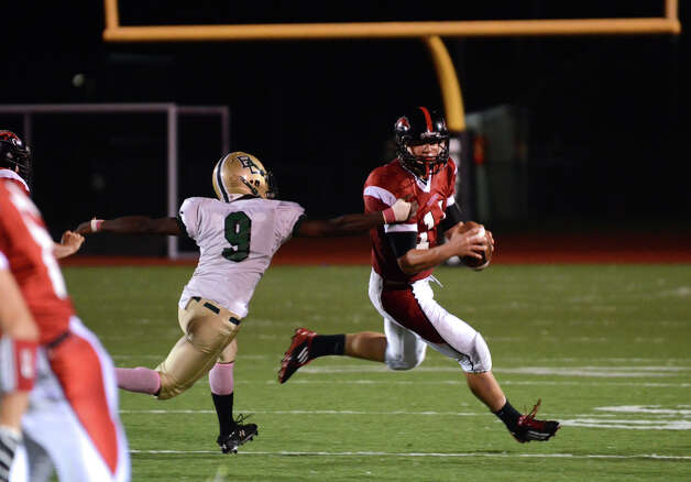 Warde's Max Garrett (11) avoids a tackle by Bassick's Julian Fyffe (9) during the football game at Tetreau/Davis Field at Fairfield Warde High School on Friday, Oct. 5, 2012. Photo: Amy Mortensen / Connecticut Post Freelance