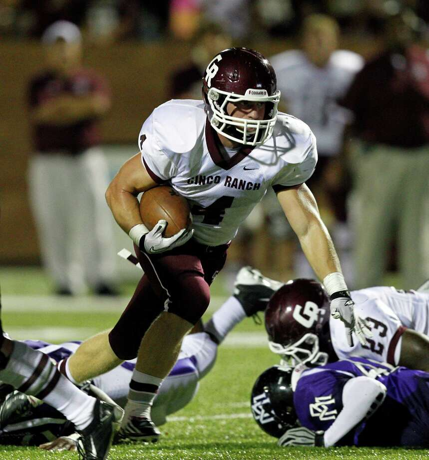 Cinco Ranch running back Adam Johnson #4 looks for room to rush against Morton Ranch during a high school football game between Morton Ranch and Cinco Ranch at Rhodes Stadium October 5, 2012 in Katy, Texas. Photo: Bob Levey, Houston Chronicle / ©2012 Bob Levey