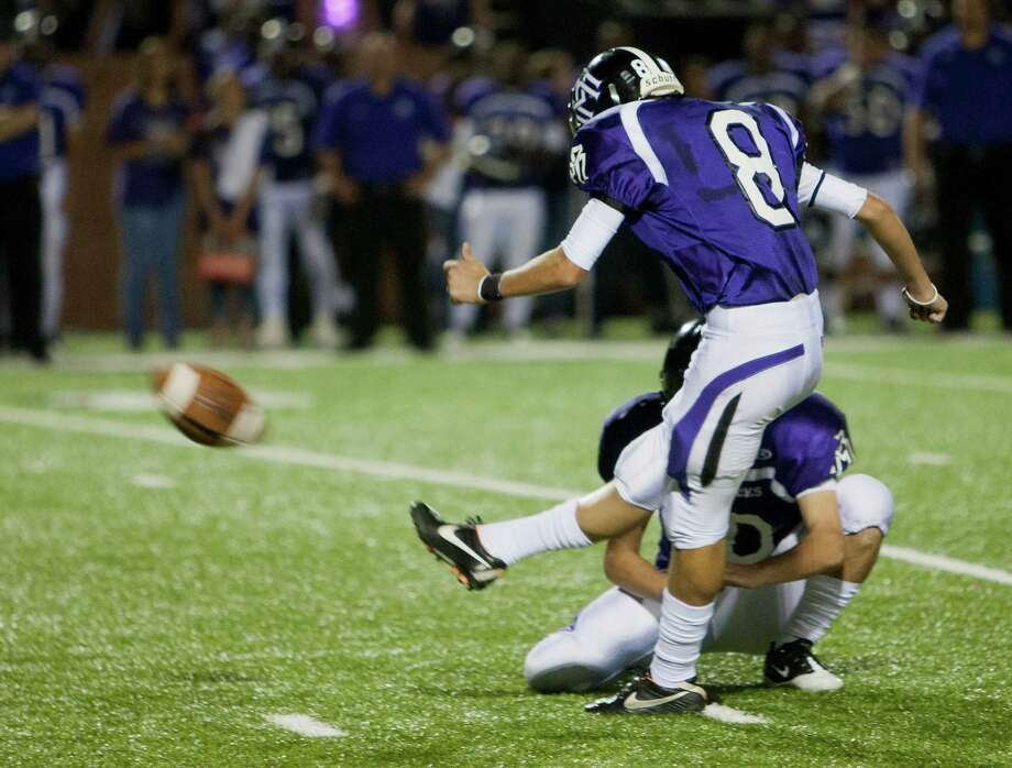 Morton Ranch kicker Aaron Shiffler #8 hits what would be the game winning field goal in the extra period against Cinco Ranch during a high school football game between Morton Ranch and Cinco Ranch at Rhodes Stadium October 5, 2012 in Katy, Texas. Morton Ranch won 38-35. Photo: Bob Levey, Houston Chronicle / ©2012 Bob Levey