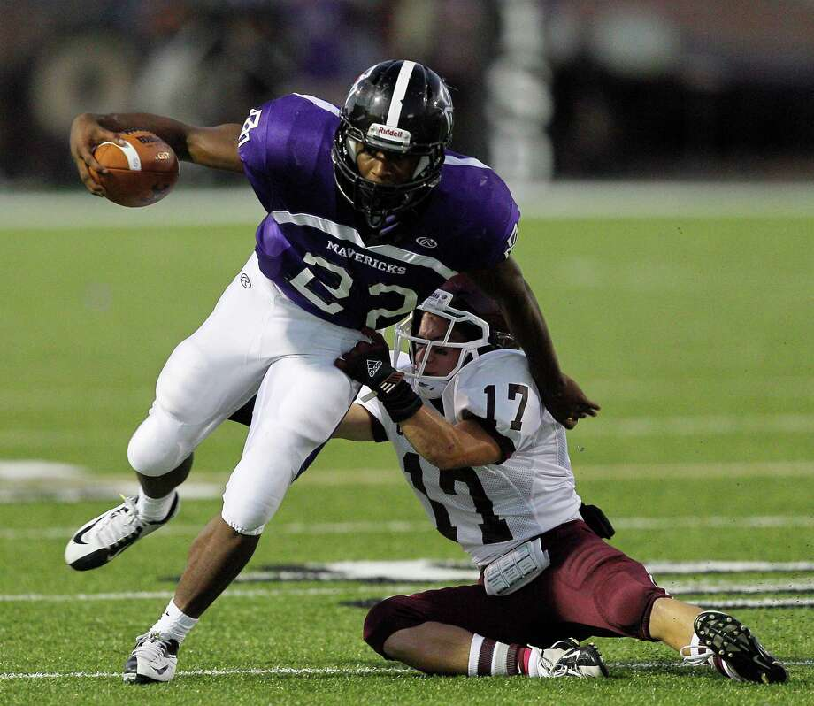 Morton Ranch running back E.J. Achelus #22  breaks loose from Cinco Ranch's Doug Johnson #17 during a high school football game between Morton Ranch and Cinco Ranch at Rhodes Stadium October 5, 2012 in Katy, Texas. Photo: Bob Levey, Houston Chronicle / ©2012 Bob Levey