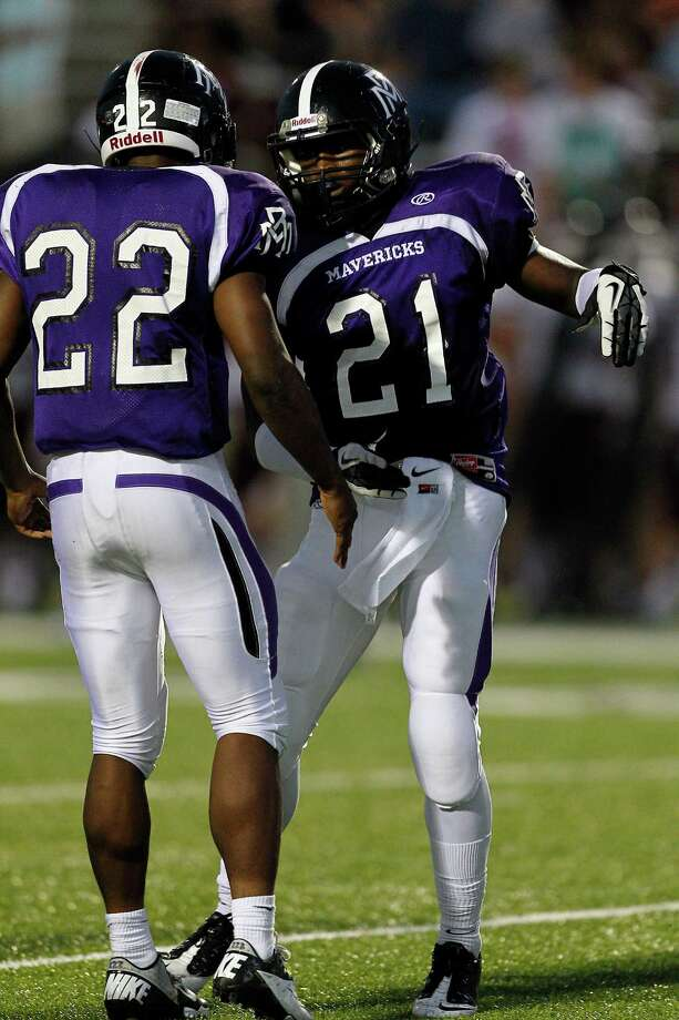 Morton Ranch's Eli Hall #21 celebrates his score with E.J. Achelus #22 during a high school football game between Morton Ranch and Cinco Ranch at Rhodes Stadium October 5, 2012 in Katy, Texas. Photo: Bob Levey, Houston Chronicle / ©2012 Bob Levey