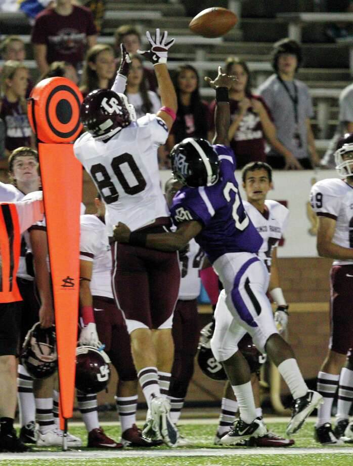 Cinco Ranch's Gabriel Sobarzo #80 makes a catch on the sideline against Morton Ranch during a high school football game between Morton Ranch and Cinco Ranch at Rhodes Stadium October 5, 2012 in Katy, Texas. Photo: Bob Levey, Houston Chronicle / ©2012 Bob Levey