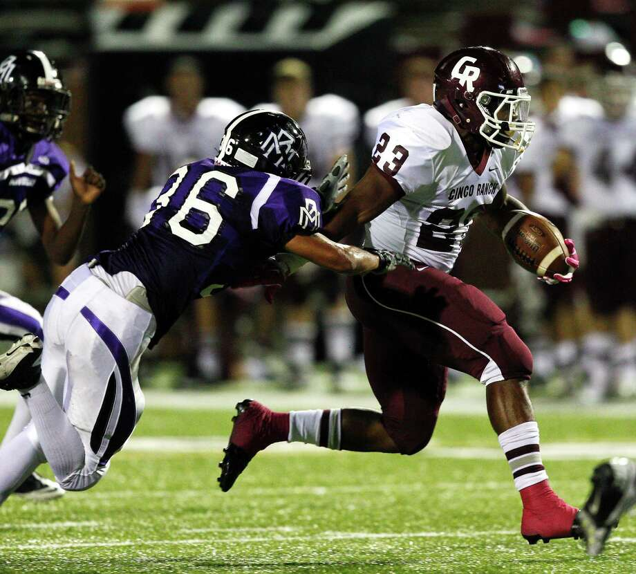 CInco Ranch's Jamel James #23 runs past Morton Ranch's Vaughan Johnson #36 during a high school football game between Morton Ranch and Cinco Ranch at Rhodes Stadium October 5, 2012 in Katy, Texas. Photo: Bob Levey, Houston Chronicle / ©2012 Bob Levey