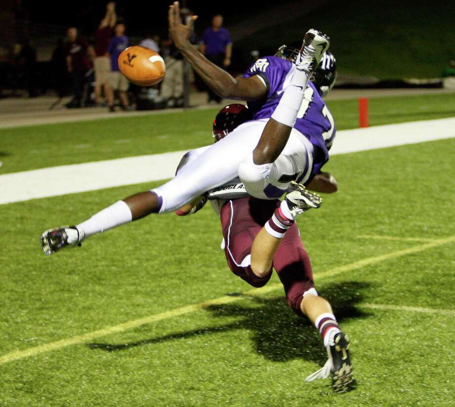 Morton Ranch wide receiver Natrail Gurley #17 can  come up with the catch as he is defended by Cinco Ranch's Doug Johnson #17 during a high school football game between Morton Ranch and Cinco Ranch at Rhodes Stadium October 5, 2012 in Katy, Texas. Photo: Bob Levey, Houston Chronicle / ©2012 Bob Levey