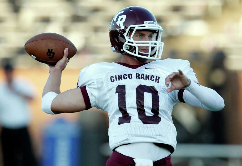Cinco Ranch quarterback Cole Thomas #10 warms up before playing Morton Ranch during a high school football game between Morton Ranch and Cinco Ranch at Rhodes Stadium October 5, 2012 in Katy, Texas. Photo: Bob Levey, Houston Chronicle / ©2012 Bob Levey