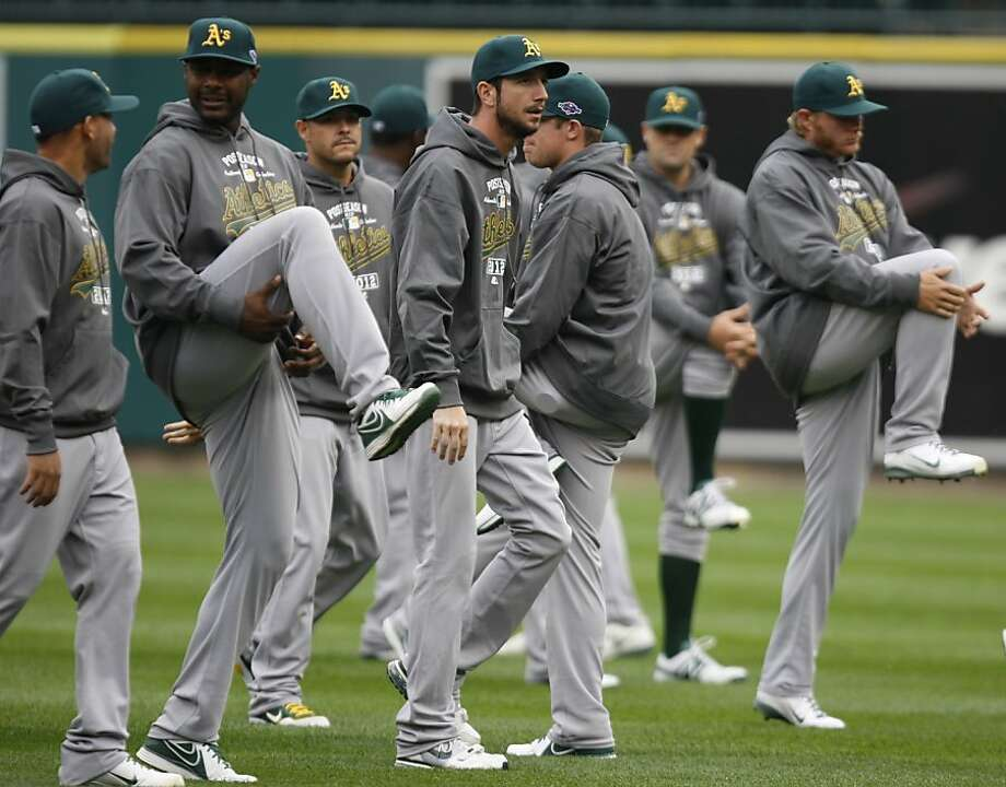 The Oakland Athletics warm up before batting practice on Friday, October 5, 2012, at Comerica Park in Detroit, Michigan. The Detroit Tigers play host to the Athletics in the ALDS opener on Saturday. (Kirthmon F. Dozier/Detroit Free Press/MCT) Photo: Kirthmon F. Dozier, McClatchy-Tribune News Service