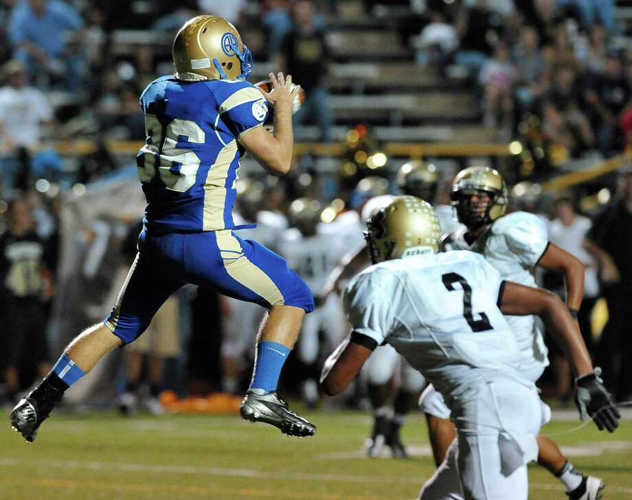 Alamo Heights' Tommy Barrow, left, leaps for a reception over Seguin's Colton Applewhite during a high school football game, Friday, Oct. 5, 2012, at Alamo Heights High School in San Antonio. Photo: Darren Abate, Express-News