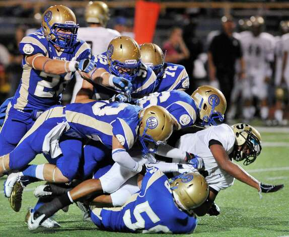 Seguin's Colton Applewhite, in white, is taken down by the Alamo Heights defense during a high school football game, Friday, Oct. 5, 2012, at Alamo Heights High School in San Antonio. Photo: Darren Abate, Express-News