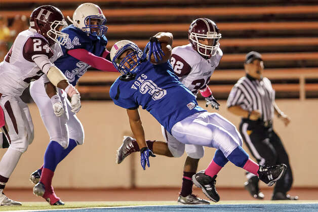 Lanier running back Isaac Cervantes (center) falls to the turf in the end zone  after scoring a touchdown during the fourth quarter of their game at Alamo Stadium on Oct. 5, 2012.  MARVIN PFEIFFER/ mpfeiffer@express-news.net Photo: MARVIN PFEIFFER, Express-News / Express-News 2012
