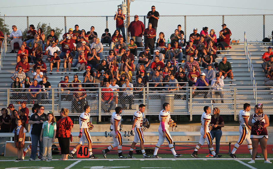 The Harlandale Indians gets cheered on by supporters before their game against Floresville in high school football in Floresville, Texas on Friday, Oct. 5, 2012. Photo: Kin Man Hui, Express-News / ©2012 San Antonio Express-News