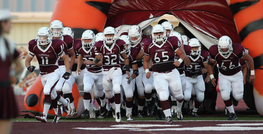 The Floresville Tigers take the field for their game against Harlandale in Floresville, Texas on Friday, Oct. 5, 2012. Photo: Kin Man Hui, Express-News / ©2012 San Antonio Express-News