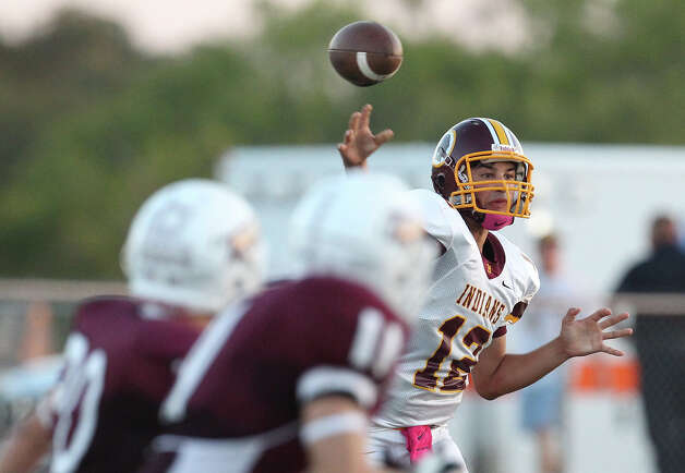 Harlandale quarterback Brandon Ramon (12) attempts a pass against Floresville in high school football in Floresville, Texas on Friday, Oct. 5, 2012. Photo: Kin Man Hui, Express-News / ©2012 San Antonio Express-News