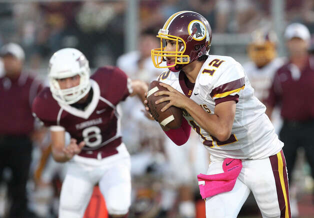 Harlandale quarterback Brandon Ramon (12) scrambles against Floresville in high school football in Floresville, Texas on Friday, Oct. 5, 2012. Photo: Kin Man Hui, Express-News / ©2012 San Antonio Express-News