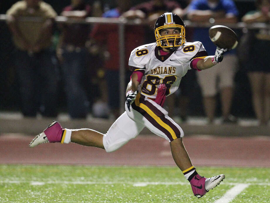 Oct. 5:Harlandale's James Mendoza reaches but misses a pass against Floresville. Photo: Kin Man Hui, Express-News / ©2012 San Antonio Express-News