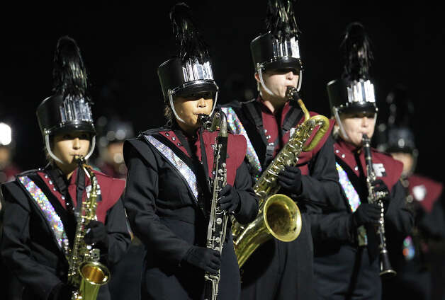 The Floresville High marching band performs at half time in Floresville, Texas on Friday, Oct. 5, 2012. Photo: Kin Man Hui, Express-News / ©2012 San Antonio Express-News