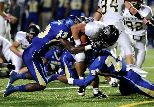 Vidor running back Sage Smith, 31, is sacked by 2 Ozen players during the Ozen football game against Vidor at the BISD Thomas Center on Friday, October 5, 2012. Photo taken: Randy Edwards/The Enterprise Photo: Randy Edwards