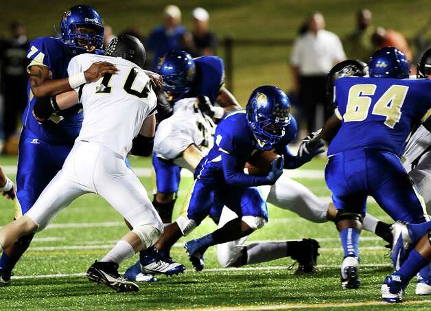 Ozen running back JaKobi Jones charges through Vidor during the Ozen football game against Vidor at the BISD Thomas Center on Friday, October 5, 2012. Photo taken: Randy Edwards/The Enterprise