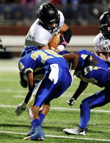 Vidor player pushes for a first down by Ozen defensive back  Raleigh Johnson during the Ozen football game against Vidor at the BISD Thomas Center on Friday, October 5, 2012. Photo taken: Randy Edwards/The Enterprise
