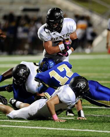 Vidor running back Sage Smith, 31, is sacked charges over Ozen players during the Ozen football game against Vidor at the BISD Thomas Center on Friday, October 5, 2012. Photo taken: Randy Edwards/The Enterprise Photo: Randy Edwards
