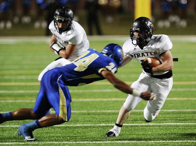 Vidor football player Bradley Byers, 1, charges past Ozen football players during the Ozen football game against Vidor at the BISD Thomas Center on Friday, October 5, 2012. Photo taken: Randy Edwards/The Enterprise Photo: Randy Edwards