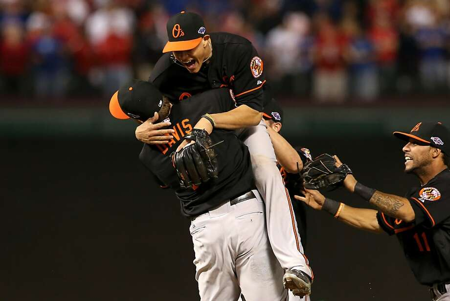 ARLINGTON, TX - OCTOBER 05:  Manny Machado (C) #13 and Chris Davis (L) #19 of the Baltimore Orioles celebrate after they won 5-1 against the Texas Rangers during the American League Wild Card playoff game  at Rangers Ballpark in Arlington on October 5, 2012 in Arlington, Texas.  (Photo by Ronald Martinez/Getty Images) Photo: Ronald Martinez, Getty Images