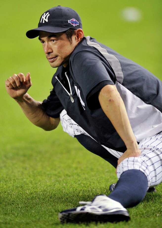New York Yankees' Ichiro Suzuki stretches during baseball practice Friday, Oct. 5, 2012, at Yankee Stadium in New York for an American League division series. (AP Photo/Bill Kostroun) Photo: Bill Kostroun
