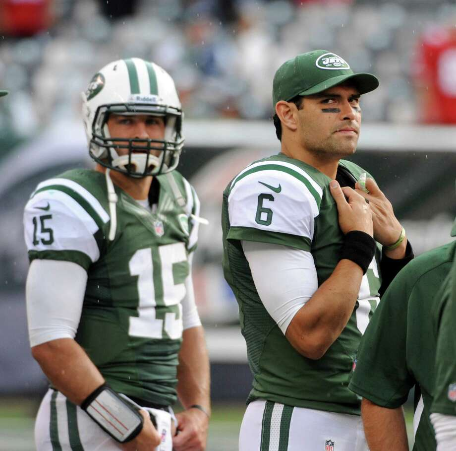 New York Jets quarterbacks Mark Sanchez (6) and Tim Tebow (15) on the sideline in the closing minutes of an NFL game against the San Francisco 49ers at MetLife Stadium in East Rutherford, N.J., Sept. 30, 2012. The 49ers won 34-0. (Barton Silverman/The New York Times) Photo: BARTON SILVERMAN / NYTNS