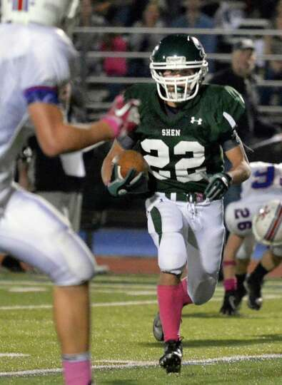 Shen's #22 Corey Acker runs the ball in for a TD against Saratoga High during Friday night's game at