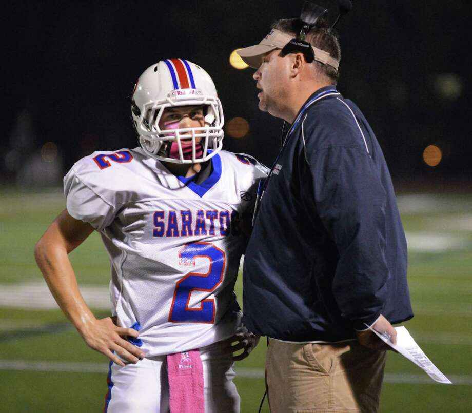 Saratoga QB #2 Jake Eglintine and head coach Terry Jones conference on the sidelines during Friday night's game at Shenendehowa Oct. 5, 2012.  (John Carl D'Annibale / Times Union) Photo: John Carl D'Annibale / 00019493A