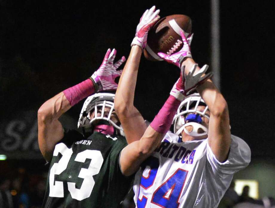 Shen's #23 Kyle Buss, left, breaks up a pass play to Saratoga's #24 Alex Chandler during Friday night's game at Shenendehowa Oct. 5, 2012.  (John Carl D'Annibale / Times Union) Photo: John Carl D'Annibale / 00019493A