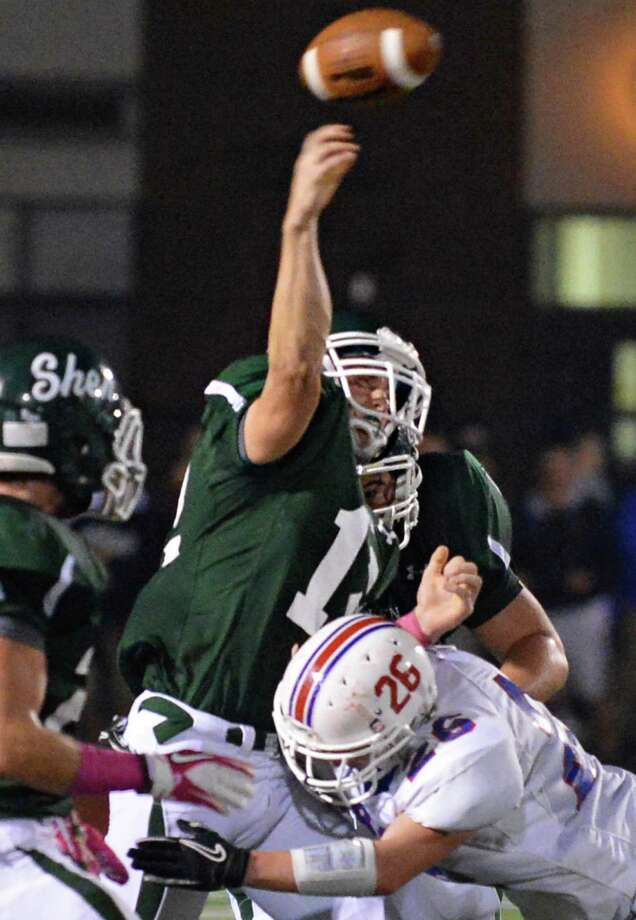 Shen's QB #12 Ryan Buss gets off a pass during Friday night's game against Saratoga High at Shenendehowa Oct. 5, 2012.  (John Carl D'Annibale / Times Union) Photo: John Carl D'Annibale / 00019493A